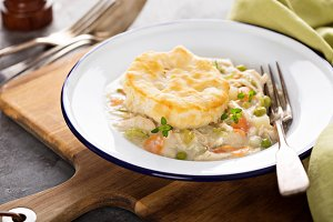Chicken pot pie with a biscuit on to