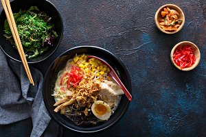Spicy ramen bowls with noodles, pork