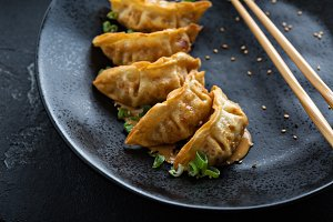 Fried potstickers with green onions