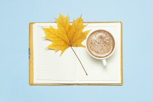Cocoa latte or coffee, notebook
