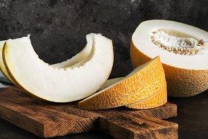 Fresh melon slices on a cutting