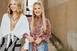 Girls laughing in urban alleyway