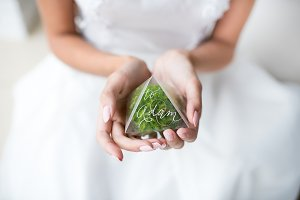 Bride holds groom's green boutonnier