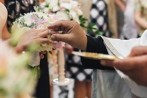 Priest puts wedding ring on bride's