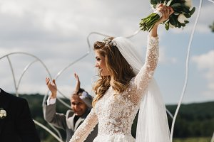 Bride raises her hand