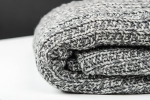 Gray wool knitted plaid