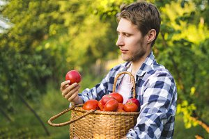 young male farmer gardener collect t