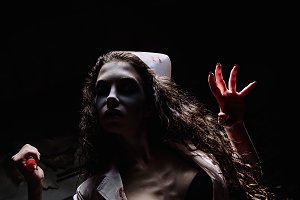 Horror shot: grim wicked mad nurse