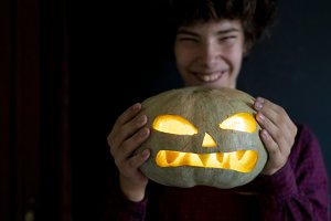 person holding jack o lantern pumpki