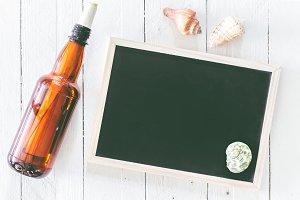 Plastic water bottle and blackboard