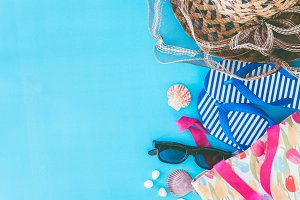 Beach accessories on blue background