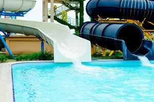 Water slide fun on outdoor pool