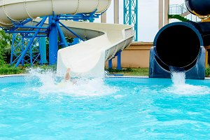 Happy child have fun on water slide