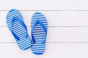 Beach flip-flops on  wooden backgrou