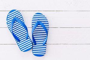 Beach flip-flops on  wooden backgrou