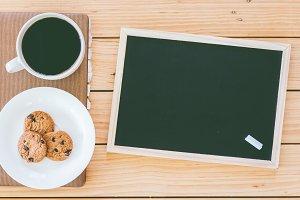 Blackboard and cup of coffee