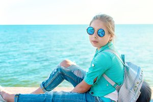 Caucasian little girl in blue eyegla