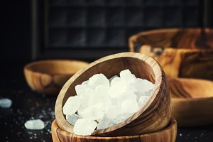 White crystal candy sugar in wooden