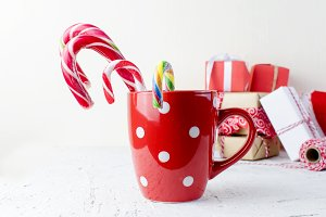 red cup of lollipops and gifts on th