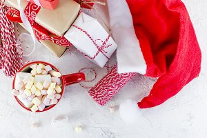 cocoa with marshmallow in red cup, G