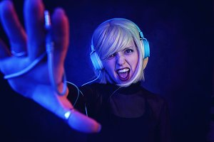 Young DJ woman in a night party
