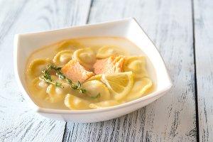 Portion of seafood ravioli soup