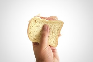 hand holding a baked ham sandwich