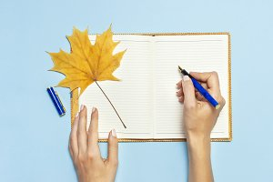 Female hands write in notebook