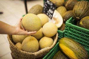 woman's hand picking a melon