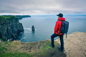 Hiker at the cliffs of Moher