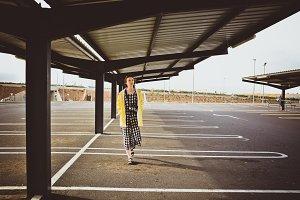 Girl walking on empty parking