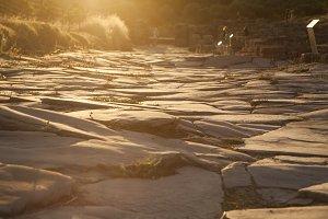 Roman road at sunset