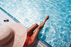 Woman Sunbathing in Swimming Pool