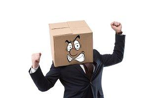 angry businessman with cardboard box