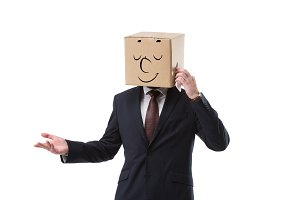 relaxed businessman with cardboard b