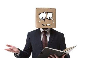stressed businessman with cardboard