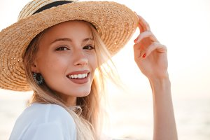 Cute blonde woman wearing hat outdoo