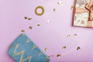 Flatlay of golden confetti and