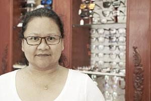 woman wearing glasses optical shop
