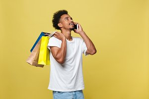 young man with shopping bags talking