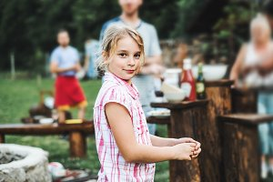 A small girl standing outdoors on a