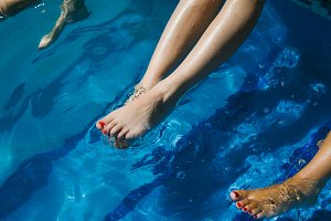 Legs of a women in a swimming pool