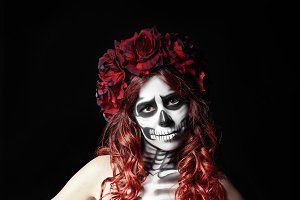 Sad young woman with calavera makeup