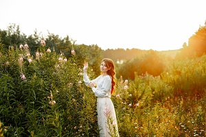 redheaded girl in a field of flowers