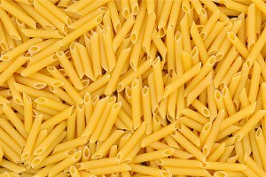 Raw Penne Pasta Closeup