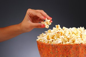 Woman's Hand and Popcorn Bowl