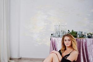 Sexy blonde model in black lingerie
