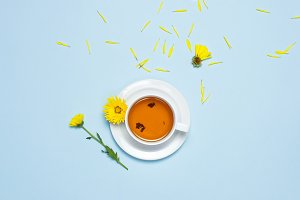 Cup of tea and yellow chrysanthemums