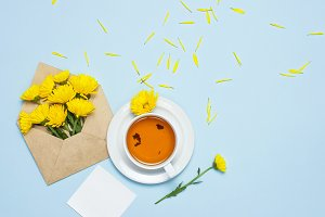 Opened envelope with yellow chrysant