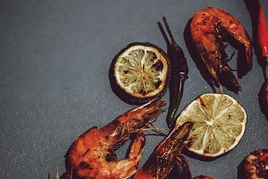 Fresh grilled prawn shrimps on grey